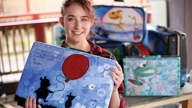 FALA student holding her art